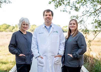 Dr. Andy Game with his staff